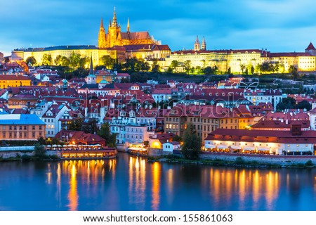 Scenic summer evening panorama of the Old Town architecture with Vltava river and St.Vitus Cathedral in Prague, Czech Republic #155861063