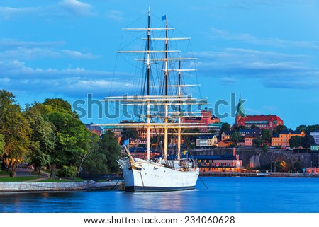 Scenic summer evening view of the Old Town (Gamla Stan) with historical tall sailing ship AF Chapman at Skeppsholmen Island in Stockholm, Sweden