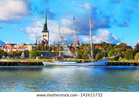 Scenic summer panorama of pier with historical tall sailing ship in the Old Town in Tallinn, Estonia