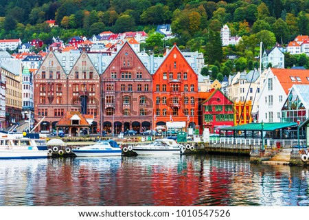 Scenic summer panorama of the Old Town pier architecture of Bryggen in Bergen, Norway #1010547526