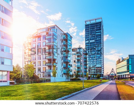Scenic summer view of the modern architecture with business skyscrapers and apartment buildings in the Vuosaari district of Helsinki, Finland #707422576