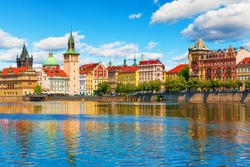 Scenic summer view of the Old Town ancient architecture and Vltava river pier in Prague, Czech Republic