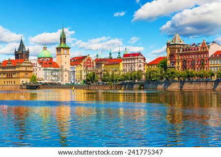 Scenic summer view of the Old Town ancient architecture and Vltava river pier in Prague, Czech Republic #241775347