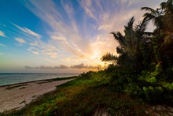 Scenic sunset in Bois Jolan beach in Guadeloupe, French west indies. Guadeloupe is an archipelago that is part of the Lesser Antilles in the Caribbean sea