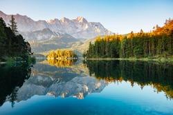 Scenic surroundings near famous lake Eibsee. Wonderful day gorgeous scene. Location resort Garmisch-Partenkirchen, Bavarian alp, sightseeing Europe. Outdoor activity. Explore the world's beauty.