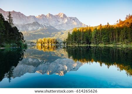 Stock Photo Scenic surroundings near famous lake Eibsee. Wonderful day gorgeous scene. Location resort Garmisch-Partenkirchen, Bavarian alp, sightseeing Europe. Outdoor activity. Explore the world's beauty.