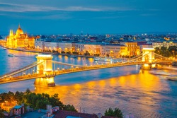 Scenic top view of the Hungarian Parliament and Chain Bridge on the Danube river at night. Location place Budapest, Hungary, Europe. Popular european travel destination. Discover the beauty of earth.