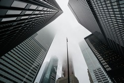 Scenic Toronto financial district skyline and modern architecture. Skyscrapers, fog and clouds concept.
