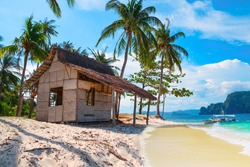 Scenic tropical landscape, El Nido, Palawan, Philippines, Southeast Asia. Beautiful tropical island with hut, sandy beach, palms. Sea bay scenery. Popular landmark, tourist destination of Philippines