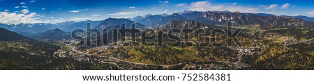 Scenic valley and snow-covered peaks under a blue sky with clouds in Estes Park, Colorado near the Rocky Mountain National Park. Aerial view from summit of Prospect Mountain. Stock photo ©