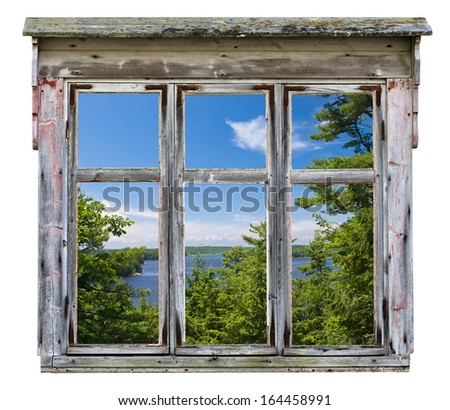 Scenic view across a river with trees, seen through an old rustic window frame