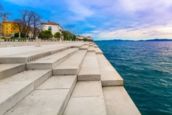 Scenic view at coastal town Zadar in Croatia, famous riva in city center, Europe. / Intentional grain effect, selective focus.