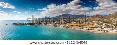 Scenic view coastal town and mountain against cloudy sky, Crete, Greece