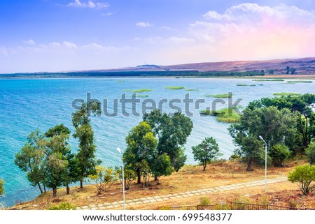 Scenic view from an old Hayravank church in Sevan, Armenia on sunny day blue sky and fluffy clouds #699548377