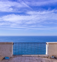 Scenic view from balcony of horizon sea in Polignano a Mare town, Apulia, Italy.