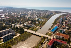 Scenic view from drone of Georgian port city of Poti located at entrance of Rioni river into Black Sea on sunny spring day, Samegrelo-Zemo Svaneti region.