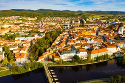 Scenic view from drone of historic center of small Czech town of Pisek on banks of Otava river on autumn day