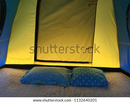 Scenic view lying in tent camping with a view of mountains. Chiang Dao Mountain in chaing Mai Thailand. adventure activity in holiday.