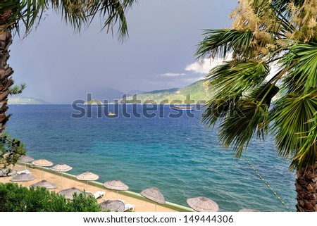 scenic view of a beach, sea and mountains under stormy sky near Marmaris