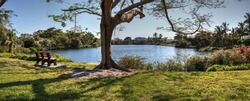 Scenic view of a pond and a park from a bench in Naples, Florida