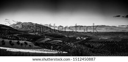Scenic view of agricultural field on mountain landscape, Crete, Greece