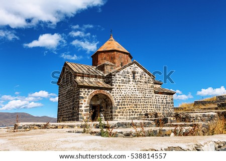 Scenic view of an old Sevanavank church in Sevan, Armenia on sunny day blue sky and fluffy clouds #538814557