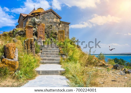Scenic view of an old Sevanavank church in Sevan, Armenia on sunny day blue sky and fluffy clouds #700224001