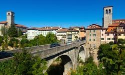 Scenic view of ancient arched bridge Ponte del Diavolo across Natisone river in small Italian town of Cividale del Friuli