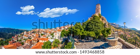 Scenic view of Arachova Village. Arachova is famous for its panoramic view, uphill small houses and the cobbled streets show a picturesque architecture at Parnassos Mountain,  Greece.