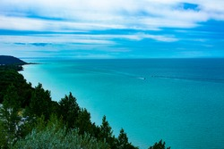 Scenic view of Arcadia and Lake Michigan at Inspiration Point along M-22 in Michigan's lower pennisula west coast. Large sand dunes and lookout tower. Calm and peaceful scene on summer day.