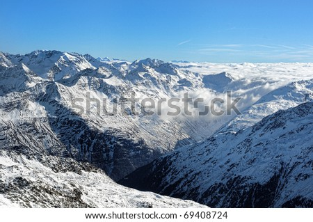 Scenic view of Austrian Alps covered with clouds.