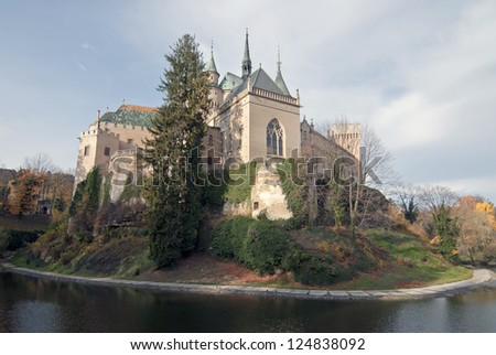 Scenic view of autumn Bojnice castle with moat in foreground, Slovakia