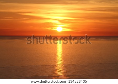 Scenic view of beautiful sunset above the sea #134528435