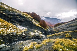 Scenic view of black valley and water source during a cloudy autumn day, Monte Cusna, Reggio Emilia, Italy