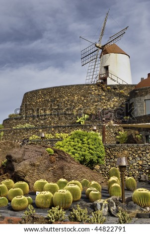 Scenic view of Cactus garden and windmill, Jardin de Cactus, Guatiza, Lanzarote, Canary Islands, Spain.