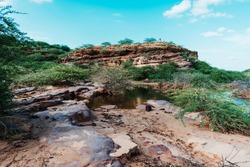 Scenic view of carved rocks by flow of river water. At Khari river in Bhuj, Kutch, Gujarat, India.