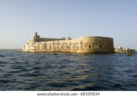 Scenic view of Castello or Maniace castle on sea, Syracuse, Sicily, Italy