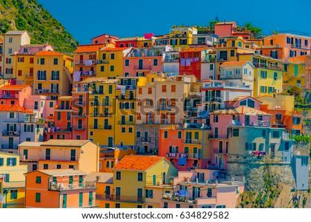 Scenic view of colorful village Manarola and ocean coast in Cinque Terre, Italy