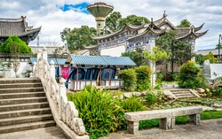Scenic view of Dali Xizhou old town with ancient buildings stone bridge and water pond in Dali Xizhou Yunnan China