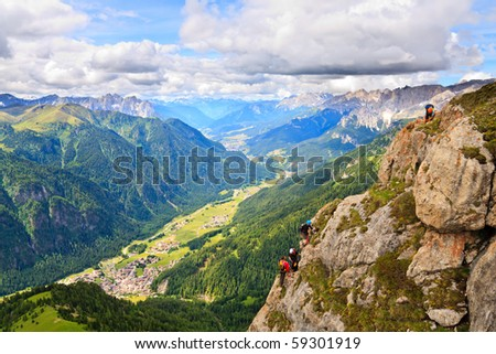 Scenic view of Dolomite valley with climbers on the rocks