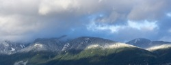 Scenic view of dramatic sky and snow mountain in Vancouver, British Columbia, Canada