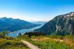 Scenic view of Gastineau Channel, Douglas Island, and Downtown Juneau from the top of Mt. Juneau in Alaska during Summer