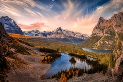 Scenic View of Glacier Lake with Canadian Rocky Mountains in Background. Dramatic Fall Sunset Sky Art Render. Located in Lake O'Hara, Yoho National Park, British Columbia, Canada.