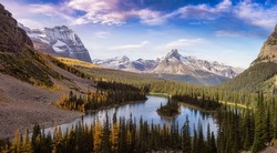Scenic View of Glacier Lake with Canadian Rocky Mountains in Background. Sunny Fall Day Art Render. Located in Lake O'Hara, Yoho National Park, British Columbia, Canada.