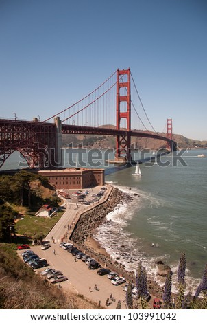 Scenic view of Golden Gate Bridge and historic Fort Point on a sunny day seen from San Francisco. / Golden Gate Bridge San Francisco California