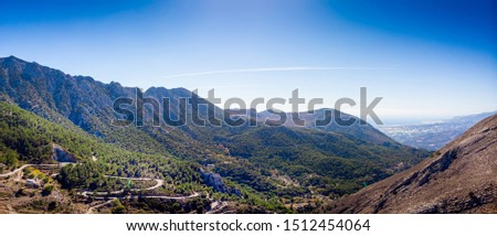 Scenic view of green mountain against sky, Crete, Greece