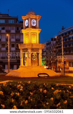 Scenic view of illuminated three tiered statue with clock on central square of Turkish city of Bursa in twilight Stok fotoğraf ©