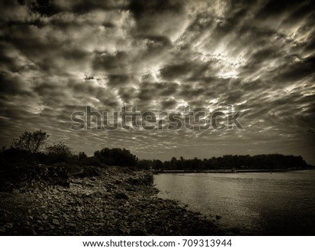 Scenic view of lake against cloudy sky #709313944