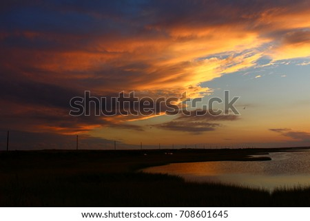 Scenic view of lake against dramatic sky #708601645