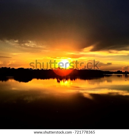 Scenic view of lake against dramatic sky #721778365